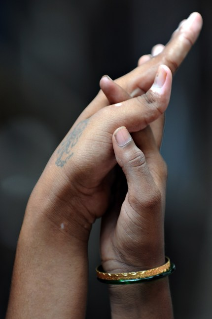 Two women holding hands, representing the gay asylum seeker couple who were asked intrusive questions by Australian authorities