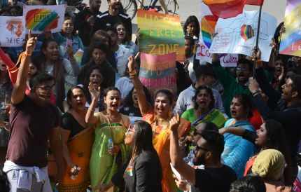 Activists and members of the lesbian, gay, bisexual, and transgender (LGBT) community in India take part in a pride parade in Siliguri on December 30 2018