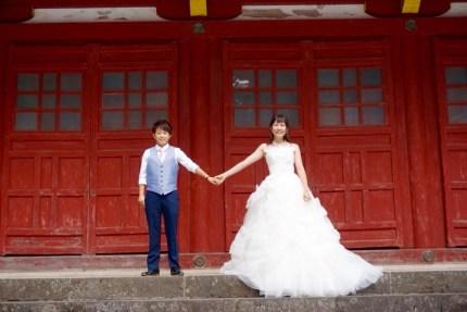 Lesbian couple Mayu Otaki (right) and Misato Kawasaki (left) pose for a wedding photo in Japan