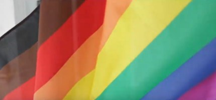 Drag queen backlash: A still of Manchester Pride's promotional video, featuring an eight-striped Pride flag