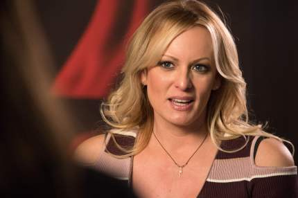"Stormy Daniels, the porn star who claims to have slept with US President Donald Trump over a decade ago, talks with a journalist during an interview at the Berlin erotic fair ""Venus"" in Berlin on October 11, 2018"