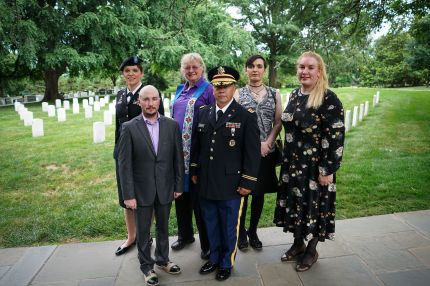 Transgender troops pose for a photo in Arlington National Cemetery, from left: retired Army lieutenant colonel Ann Murdoch, Transgender American Veterans Association Vice President Gene Silvestri, Yvonne Cook-Riley, retired Army major and Transgender American Veterans Association President Evan Young, petty officer first class Alice Ashton and retired Air Force major Nella Ludlow