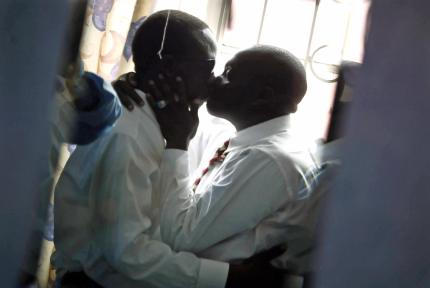 Two men share a kiss in Nairobi, Kenya