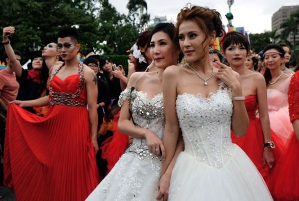 Two participants pose during the annual Taiwan lesbian, gay, bisexual and transgender pride parade in Taipei, Taiwan on October 29, 2016