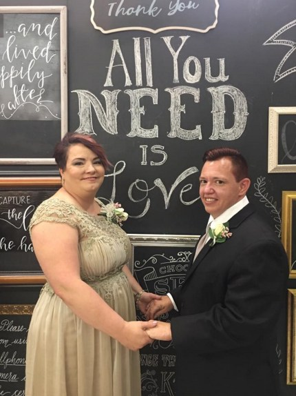 Transgender nurse Jesse Vroegh poses for a wedding picture with his wife Jackie