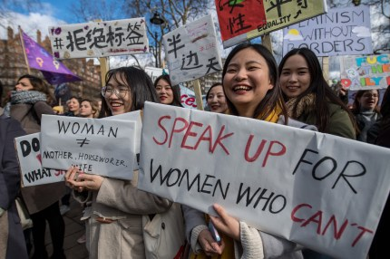 Women's rights demonstrators hold placards during a rally in Russell Square on International Women's Day on March 8, 2018 in London, England. International Women's Day is annually held on March 8 to celebrate women's achievements throughout history and across nations. It is also known as the United Nations (UN) Day for Women's Rights and International Peace.