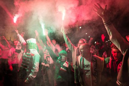 Fans of Warsaw's soccer team Legia Warszawa burn flares as they celebrate their club's victory of the Polish soccer championship on May 15, 2016 in Warsaw.