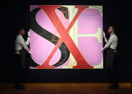 Staff members poses with work by Michael Craig-Martin as Christie's presents an exhibition of works from it's George Michael Collection Highlights at Christie's on March 08, 2019 in London, England.