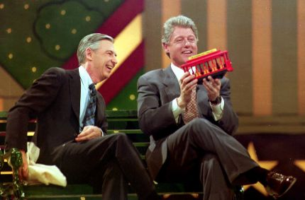 "U.S. President-elect Bill Clinton (R) holds a trolley car given to him by Fred Rogers (L) during the Presidential Inaugural Celebration for Children 19 January 1993 at the Kennedy Center. Fred Rogers was the host of the children's show ""Mister Rogers' Neighborhood""."