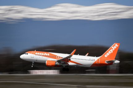 An EasyJet Airbus A320 commercial plane with registration HB-JXF is landing at Geneva Airport on March 22, 2019 in Geneva.