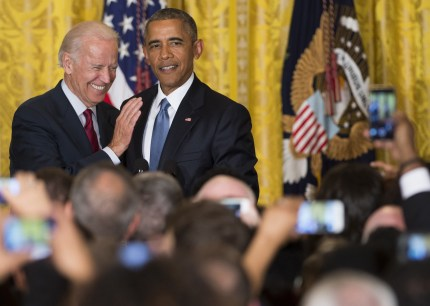 Joe Biden LGBT rights record: US President Barack Obama and US Vice President Joe Biden attend a reception in honor of LGBT Pride Month in the East Room of the White House in Washington, DC, June 24, 2015.