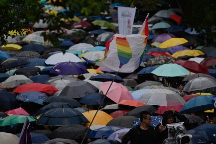 Gay rights supporters wait for the results under the rain outside Parliament while law makers discusses the same sex marriage bill in Taipei on May 17, 2019.