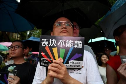 A gay rights supporter displays a placard in support of same-sex marriage in Taiwan.