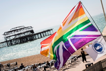 A rainbow Union Jack is flown on the beach during Brighton Pride.