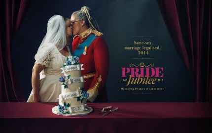 A Pride Jubilee billboard of a lesbian couple marrying