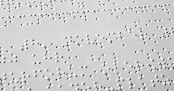 A sheet of plain white Braille rests flat.