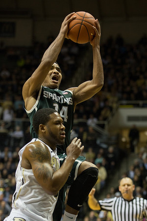 Michigan State's Gary Harris (14) is fouled by Purdue' Terone Johnson (0)