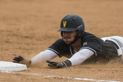 Mark Johnson slides into third base during the baseball game between the Valparaiso Crusaders and the Purdue Boilermakers on May 12, 2015