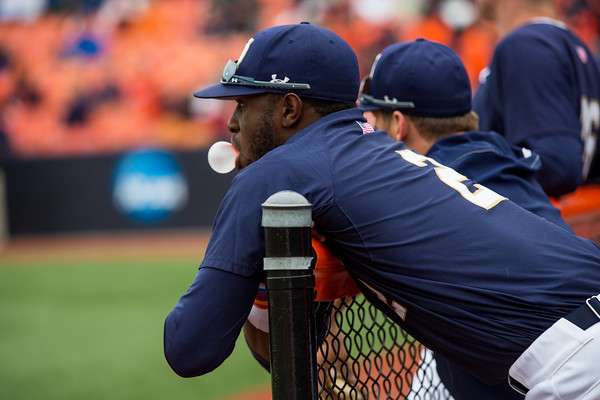 Torii Hunter Jr. sits in the dugout prior to NCAA Champaign Regional Game between Notre Dame and Illinois on May 31, 2015