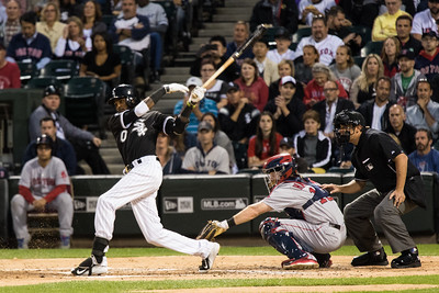 Alexei Ramirez bats during the Chicago White Sox game against the Boston Red Sox on August 25, 2015