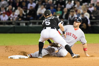 Carlos Sanchez tags out Travis Shaw during the Chicago White Sox game against the Boston Red Sox on August 25, 2015