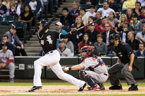 Trayce Thompson hits a triple in the second inning of the Chicago White Sox game against the Boston Red Sox on August 25, 2015