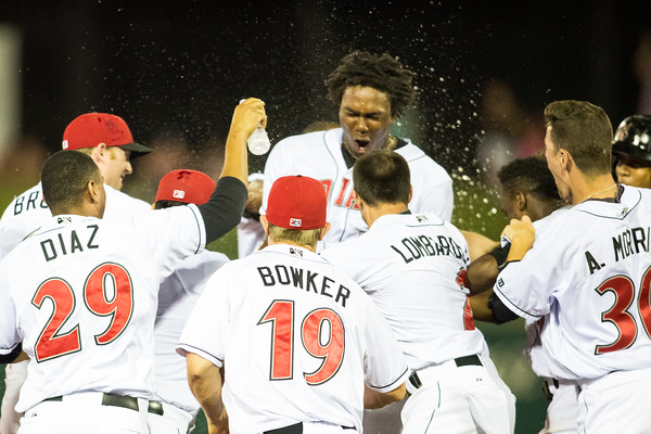 Josh Bell of the Indianapolis Indians celebrates his 13th inning walk off against the Charlotte Knights on August 1, 2015