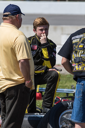 Austin Nemire takes a break prior to the Day Before the 500 race at Lucas Oil Raceway in Speedway, Indiana on May 23, 2015.