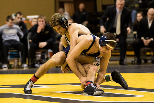 Danny Sabatello beats Zebulan Hilyard during the match at Purdue. #16 Michigan won 26-9