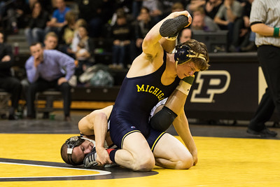 Doug Welch and Brian Murphy wrestle during the match at Purdue. #16 Michigan won 26-9