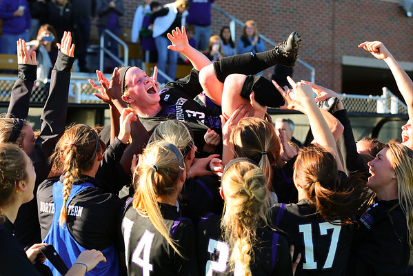 Michelle Manning is lifted up by her #8 Northwestern teammates after scoring the winning goal in the upset victory over #1 Penn State