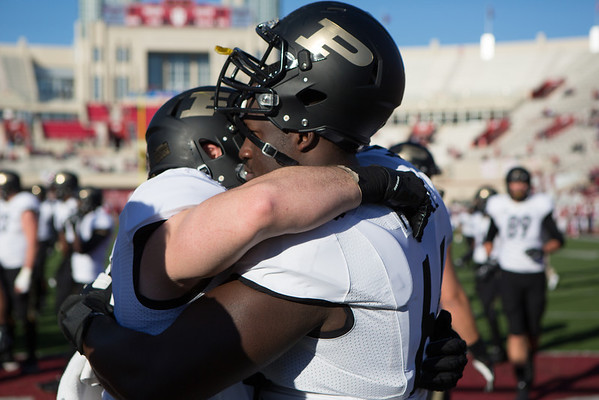 Kurt Freytag (46) and Kevin Pamphile (64) embrace before the Old Oaken Bucket game