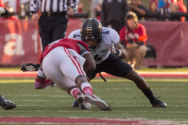 Purdue defensive back Taylor Richards (4) tackles Indiana quarterback Tre Roberson during the Old Oaken Bucket game between the Purdue Boilermakers and the Indiana Hoosiers