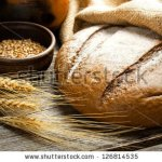 stock-photo-fresh-bread-and-wheat-on-the-wooden-126814535