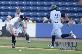 Will Carter picks up the ball after committing a fielding error that allowed the Cyclones to load the bases (Robert M. Pimpsner)