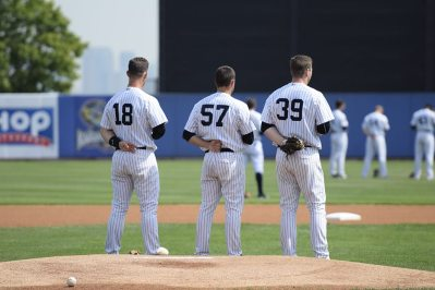 Drew Bridges, Kolton Mahoney and Ryan Krill salute for the national anthem (Robert M Pimpsner)