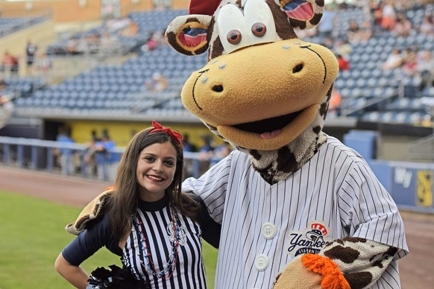 Scooter the Holy Cow and a member of the Pinstripe Patrol before the game (Robert M Pimpsner)