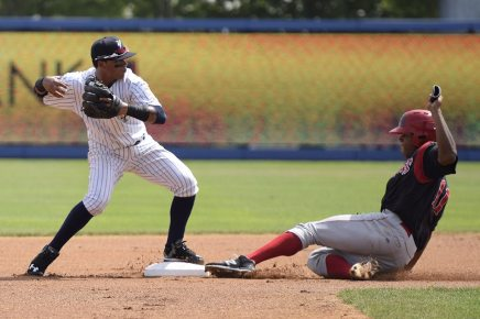 Stone Garrett slides into second base, breaking up a double play in the first inning (Robert M Pimpsner)