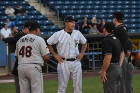 The two managers meet with the umpire crew prior to the game (Robert M Pimpsner)