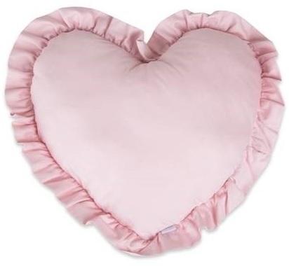 Na białym tle różowa poduszka w kształcie serca
