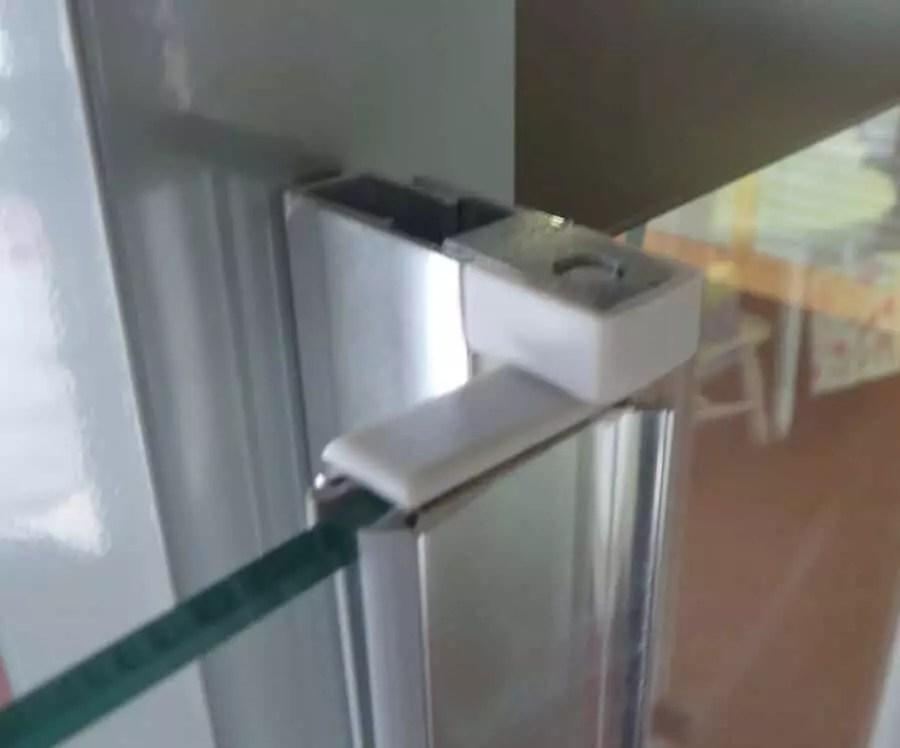 Shower enclosure pivot hinge door