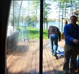 Dirty, cloudy sliding patio door being prepared for replacement by Jake and Tom!