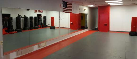 A full-length mirror in a karate studio