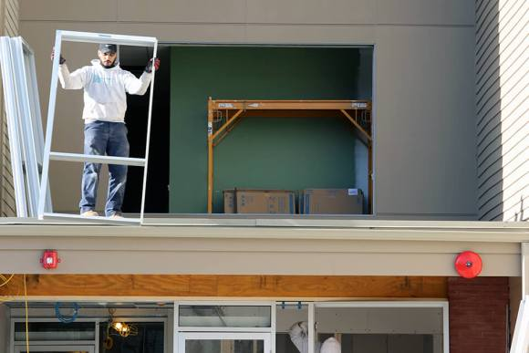 Pioneer Installing Window Glass for Commercial Building