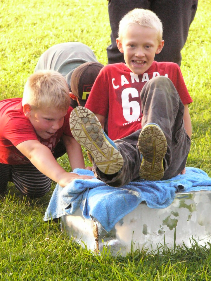 Ontario Camp Cherith boys playing on a block of ice