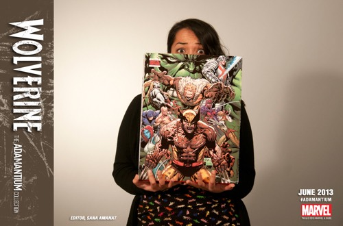 Marvel editor Sana Amanat holds up a copy of the hefty Wolverine: The Adamantium Collection.