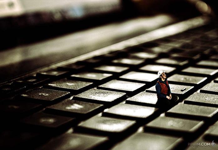 man-sitting-on-a-keyboard