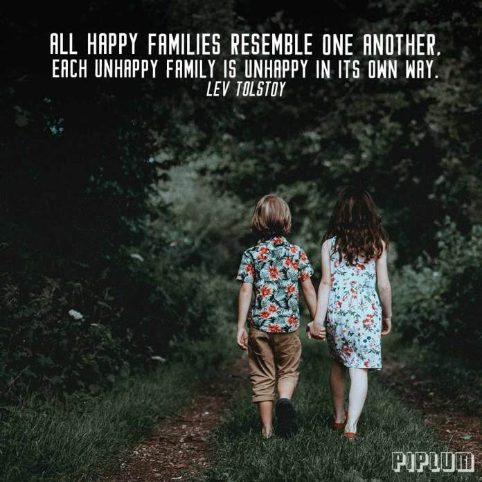 Family Quote. Brother and sister holding hands in the forest.