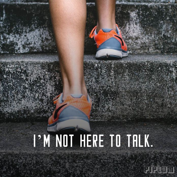 Workout Quote. Women steps on a stairs. Only sneakers visible.