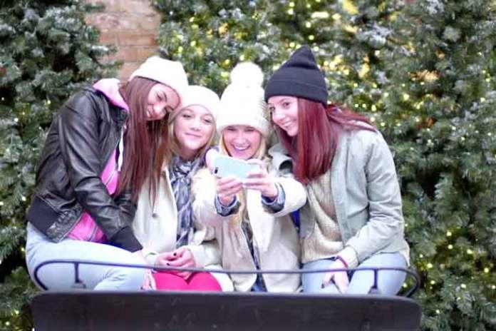 Girls-taking-group-selfie-for-christmas
